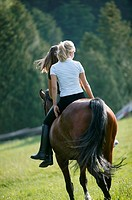 Two young women on a horse