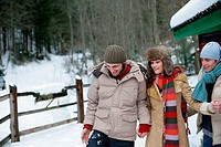 Friends walking in the snow (thumbnail)