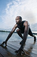 Man stretching on dock