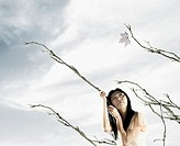 Woman holding branches