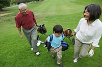 Grandparents playing golf with grandson