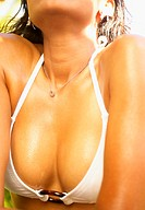 Close up of woman's chest in bikini top