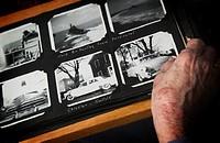 Senior woman looking at old photographs