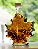 Maple Syrup in a Leaf Shaped Bottle, On Window Sill