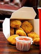 Chicken Nuggets in a Take-Out Box with Ketchup