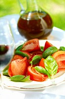Tomatoes with fresh basil (thumbnail)