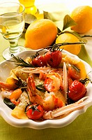 Ravioli with scampi, tomatoes & rosemary, lemons, white wine