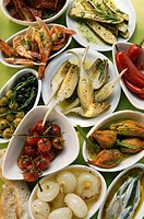 Assorted antipasti: pickled vegetables, fish, scampi