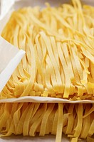 Ribbon pasta on paper (thumbnail)