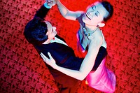 High angle view of a young couple dancing in a nightclub