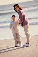 Portrait of a mother and her son standing on the beach (thumbnail)