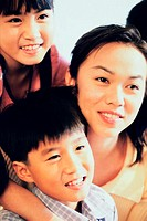 Close-up of a mother with her two sons (thumbnail)