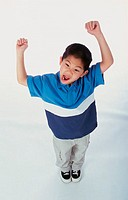 High angle view of a boy with his arms raised