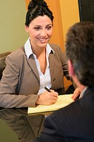 Businesswoman looking at a businessman in an office
