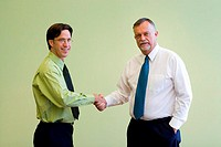 Portrait of two businessmen shaking hands