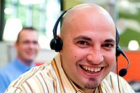 Close-up of a male customer service representative wearing a headset