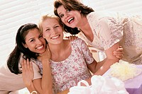 Portrait of three young women smiling at a baby shower (thumbnail)