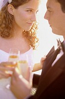 Close-up of a newlywed couple looking at each other