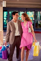 Young couple carrying shopping bags