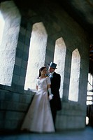 Newlywed couple standing in a castle