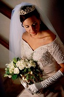 High angle view of a bride holding a bouquet of flowers
