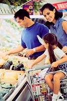 Parents and their daughter shopping in a supermarket