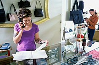 Young woman talking on a telephone in a store