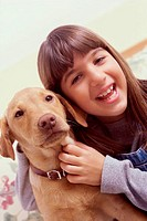 Close-up of a girl holding her dog