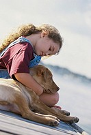 Girl sitting with her dog
