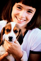 Portrait of a girl holding her puppy
