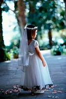 Flower girl wearing a headdress and a veil