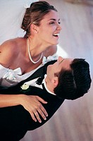 High angle view of a newlywed couple dancing
