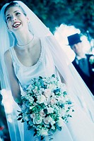 Bride holding a bouquet of flowers smiling