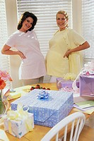 Portrait of two pregnant women standing at a baby shower