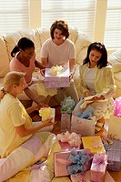 Group of young women sitting together at a baby shower