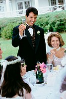 Group of people at a wedding toasting with glasses of champagne