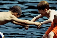 Side profile of two boys playing in the water