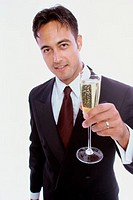 Portrait of a young man holding a glass of champagne