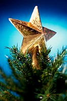 Close-up of a Christmas star on top of Christmas tree