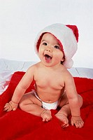 Close-up of a baby boy wearing a Christmas hat