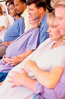Husbands and their pregnant wives at a prenatal class