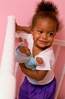 High angle view of a baby girl holding a doll (thumbnail)