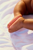 Low section view of a baby's feet