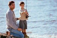 Father teaching his son fishing