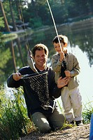Father and his son fishing