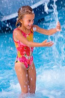 Girl playing in a swimming pool