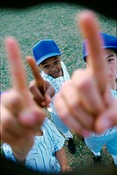 High angle view of three boys from a little league baseball team