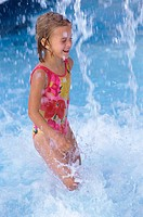 Side profile of a girl playing in swimming pool