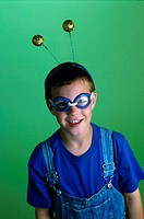 Portrait of a boy wearing antennae and swimming goggles