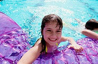 Portrait of a girl playing in a swimming pool